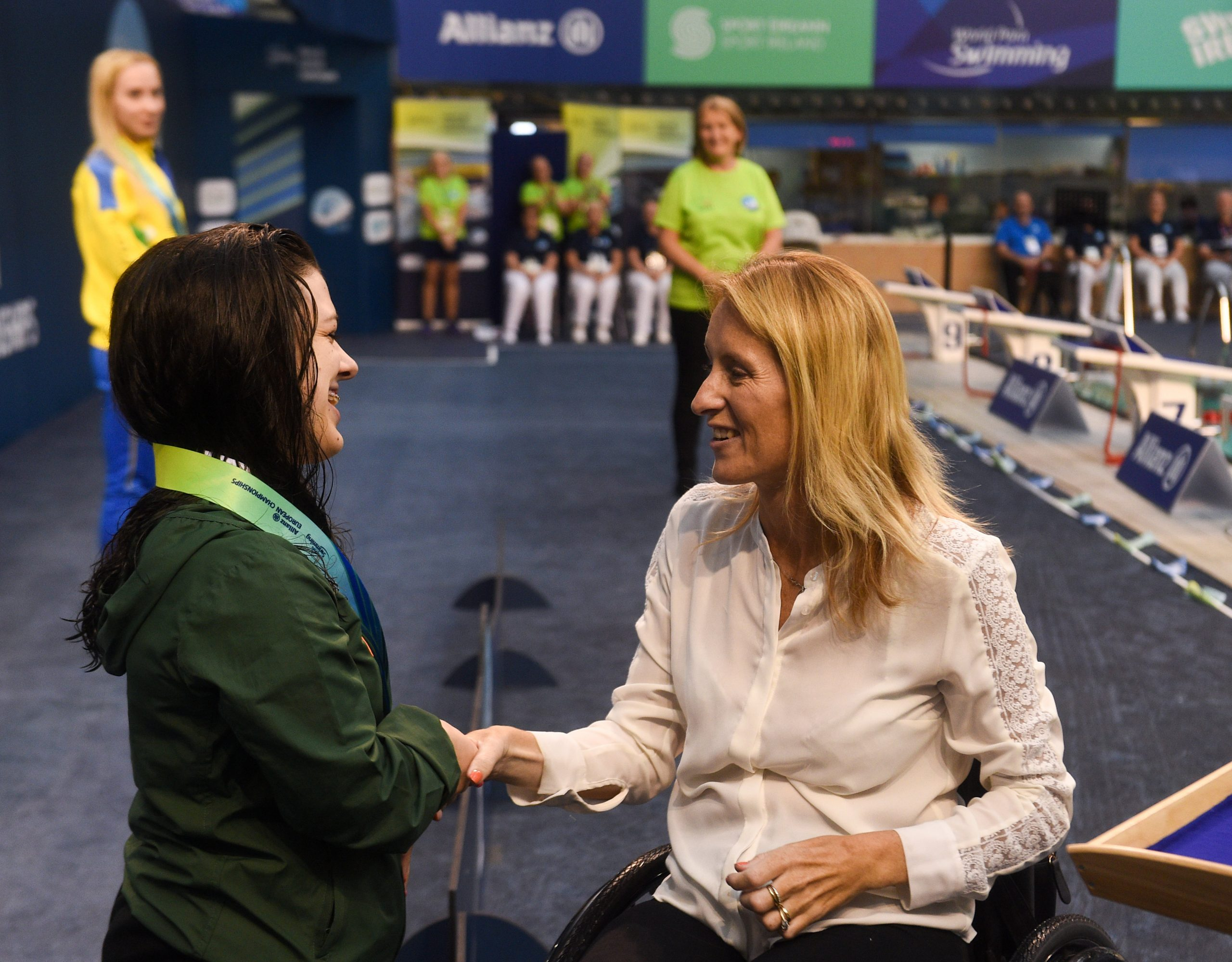 18 August 2018; Nicole Turner of Ireland is presented with her silver medal by Eimear Breathnach after finishing in second place in the final of the Women's 50m Butterfly S6 event during day six of the World Para Swimming Allianz European Championships at the Sport Ireland National Aquatic Centre in Blanchardstown, Dublin. Photo by David Fitzgerald/Sportsfile ***NO REPRODUCTION FEE***