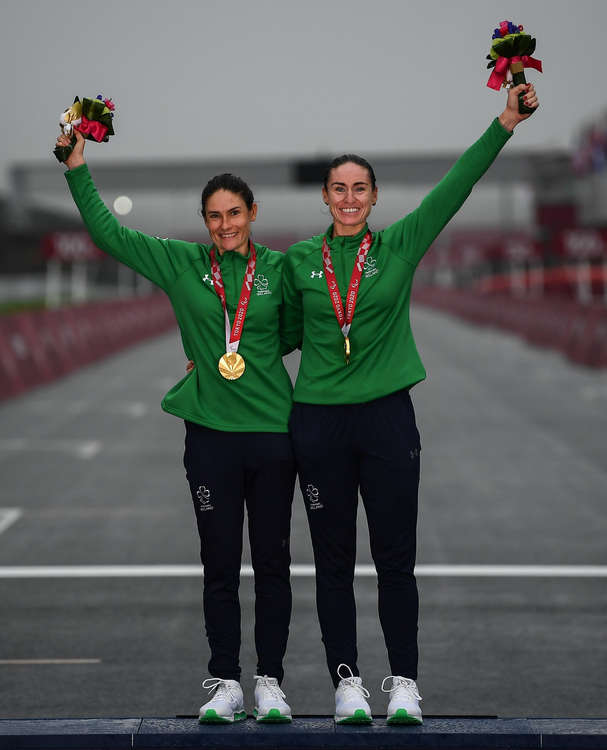 3 September 2021; Eve McCrystal, right, and Katie George Dunlevy of Ireland on the podium with their gold medals after winning the Women's B road race at the Fuji International Speedway on day ten during the 2020 Tokyo Summer Olympic Games in Shizuoka, Japan. Photo by David Fitzgerald/Sportsfile *** NO REPRODUCTION FEE ***